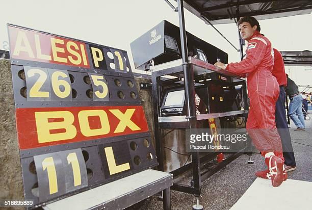 Jean Alesi of France, driver of the Scuderia Ferrari Ferrari F93A Ferrari V12 in the pit box during practice for the Italian Grand Prix on 11th...