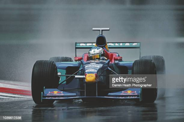 Jean Alesi of France drives the Red Bull Sauber Petronas Sauber C17 Petronas V10 in the rain during practice for the Formula One Italian Grand Prix...