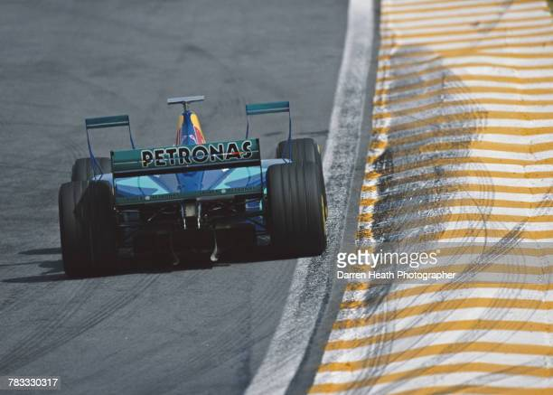 Jean Alesi of France drives the Red Bull Sauber Petronas Sauber C17 Petronas V10 with the aerodynamic XWings during the Formula One Brazilian Grand...