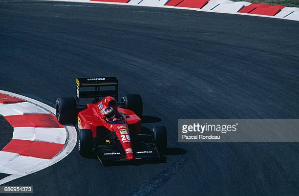 Jean Alesi of France drives the Scuderia Ferrari SpA Ferrari 643 Ferrari V12 during practice for the French Grand Prix on 6 July 1991 at the Circuit...