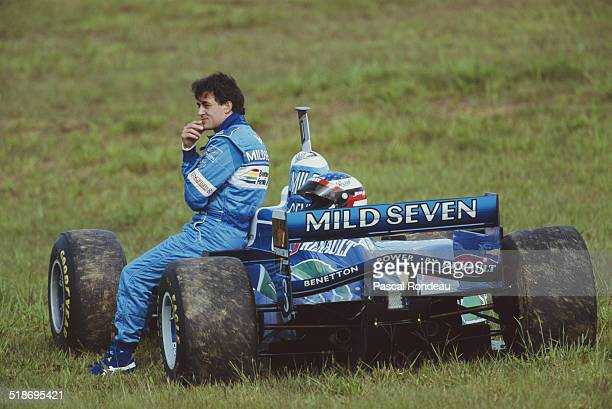 Jean Alesi of France sits beside his Mild Seven Benetton Renault Benetton B196 Renault V10 during practice for the Brazilian Grand Prix on 30th March...