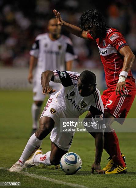 Jean Alexandre of Real Salt Lake tries to control the ball along the touch line under pressure from Wilman Conde of the Chicago Fire in an MLS match...