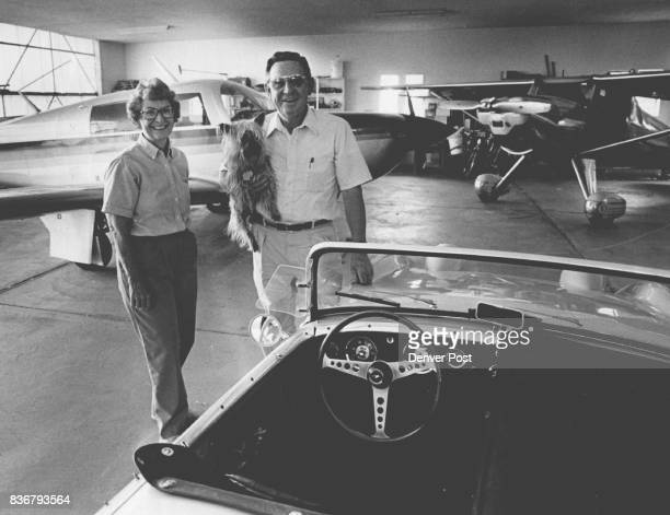 Jean and Scotty Knox with pooch in their hanger/garage that houses two planes and an old Bugeyed Sprite at the Bann Aire Estates Credit The Denver...