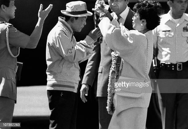 Jean Ariyoshi Hawaii's governor's wife greets 26 February 1986 former Philipppine President Ferdinand Marcos as the deposed president arrives at...
