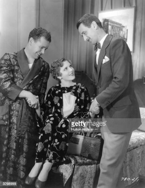 Jean Arthur with Regis Toomey and John Cromwell during the filming of 'Street Of Chance' directed by Cromwell for Paramount