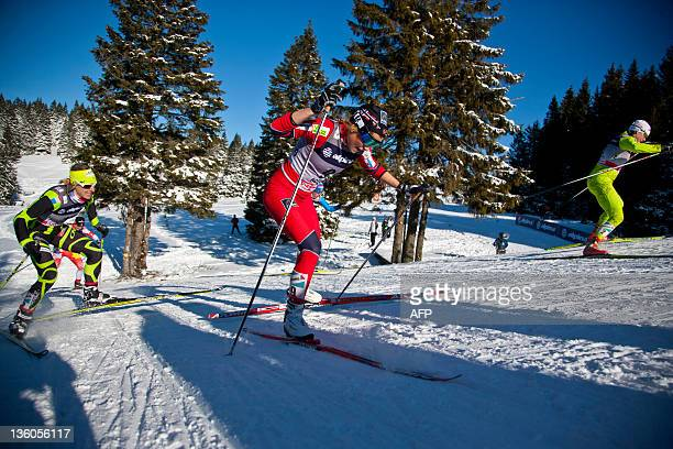 Jean Aurore of France Marthe Kristoffersen of Norway and Barbara Jezersek of Slovenia compete during the women's 1km free sprint at the FIS Ski...