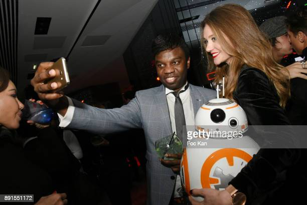 Jean Barthelemy Bokassa and TV presenter Cyrielle Joelle attend the Star Wars Party at Le Saint Fiacre on December 12 2017 in Paris France