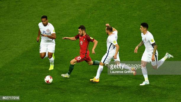 Jean Beausejour of Chile and Marcelo Diaz of Chile attempt to stop Bernardo Silva of Portugal from breaking through during the FIFA Confederations...