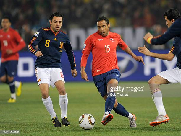 Jean Beausejour of Chile battles for the ball with Xavi of Spain during the 2010 FIFA World Cup South Africa Group H match between Chile and Spain at...