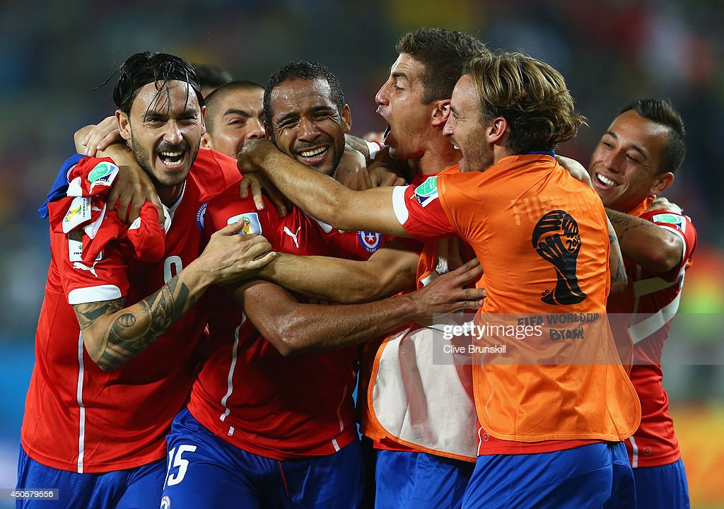 Jean Beausejour of Chile (C) celebrates scoring his team's third goal with teammates during the 2014 FIFA World Cup Brazil Group B match between Chile and Australia at Arena Pantanal on June 13, 2014 in Cuiaba, Brazil.
