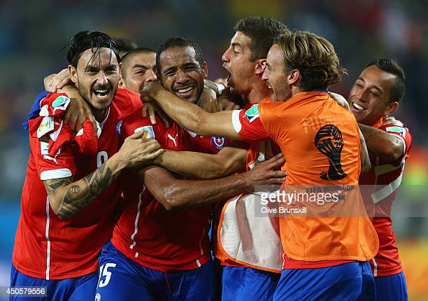 Jean Beausejour of Chile celebrates scoring his team's third goal with teammates during the 2014 FIFA World Cup Brazil Group B match between Chile...