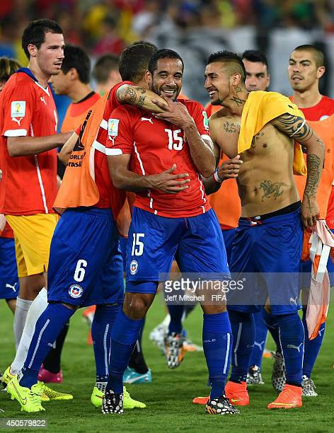 Jean Beausejour of Chile celebrates with teammates after scoring a goal during the 2014 FIFA World Cup Brazil Group B match between Chile and...