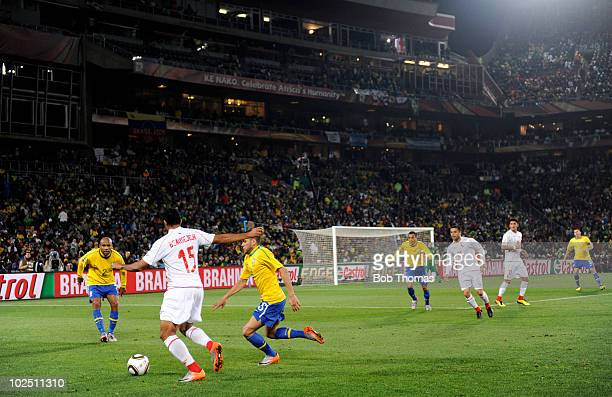 Jean Beausejour of Chile challenged by Dani Alves of Brazil during the 2010 FIFA World Cup South Africa Round of Sixteen match between Brazil and...