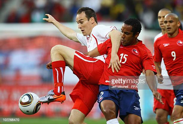 Jean Beausejour of Chile challenges Steve von Bergen of Switzerland during the 2010 FIFA World Cup South Africa Group H match between Chile and...
