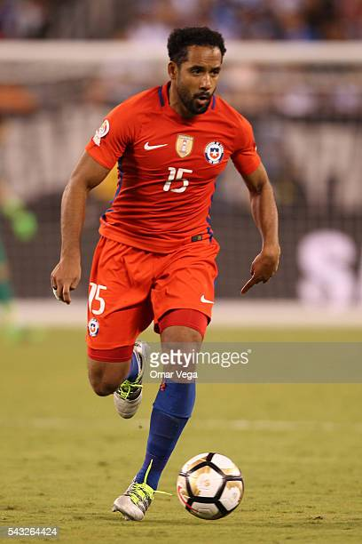 Jean Beausejour of Chile drives the ball during the championship match between Argentina and Chile at MetLife Stadium as part of Copa America...