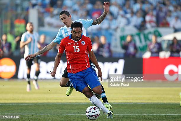 Jean Beausejour of Chile fights for the ball with Angel di Maria of Argentina during the 2015 Copa America Chile Final match between Chile and...