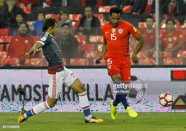 Jean Beausejour of Chile fights for the ball with Oscar Romero of Paraguay during a match between Chile and Paraguay as part of FIFA 2018 World Cup...