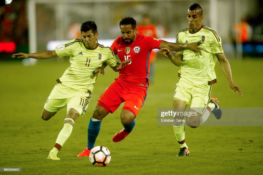 Jean Beausejour of Chile fights for the ball with Renzo Zambrano of Venezuela during a match between Chile and Venezuela as part of FIFA 2018 World Cup Qualifier at Monumental Stadium on March 28, 2017 in Santiago, Chile.