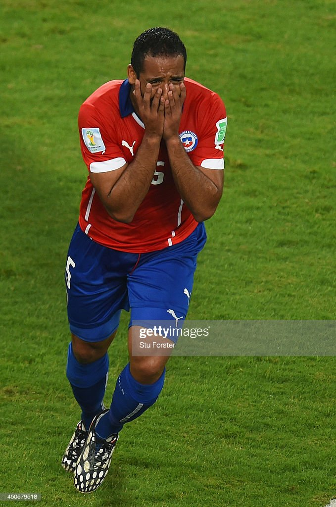 Jean Beausejour of Chile reacts after scoring his team's third goal during the 2014 FIFA World Cup Brazil Group B match between Chile and Australia at Arena Pantanal on June 13, 2014 in Cuiaba, Brazil.