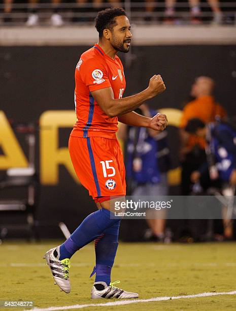 Jean Beausejour of Chile reacts to his penalty shootout goal during the penalty shootout the championship match between Argentina and Chile at...