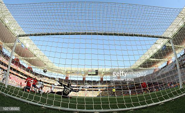 Jean Beausejour of Chile scores the opening goal past Noel Valladares of Honduras during the 2010 FIFA World Cup South Africa Group H match between...