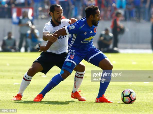 Jean Beausejour of U De Chile fights for the ball with Luis Pedro Figueroa of Colo Colo during a match between U de Chile and Colo Colo as part of...