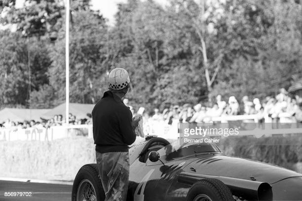 Jean Behra Maserati 250F Grand Prix of France RouenLesEssarts 07 July 1957 An oil soaked Jean Behra just climbed out of his Maserati 250F which just...