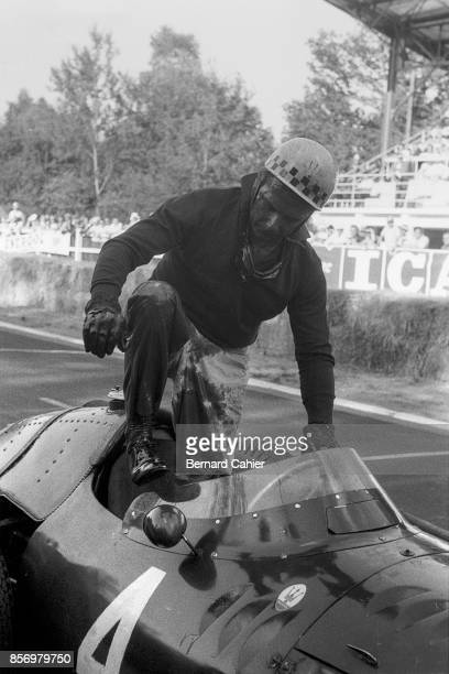 Jean Behra Maserati 250F Grand Prix of France RouenLesEssarts 07 July 1957 An oil soaked Jean Behra climbs out of his Maserati 250F which just...
