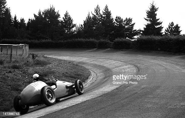 Jean Behra of France drives the Equipe Gordini Gordini Type 16 Gordini Straight6 through the Karussell during the Formula Two German Grand Prix on...