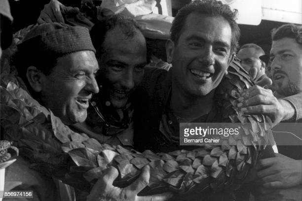 Jean Behra, Stirling Moss, Jo Bonnier, Maserati 300S, 1000 Km of Nürburgring, Nurburgring, 27 May 1956. Jean Behra and Stirling Moss, celebrate with...