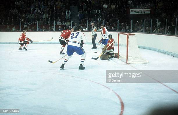 Jean Beliveau and Frank Mahovlich of the Montreal Canadiens look to score as goalie Tony Esposito and Bill White of the Chicago Blackhawks look to...