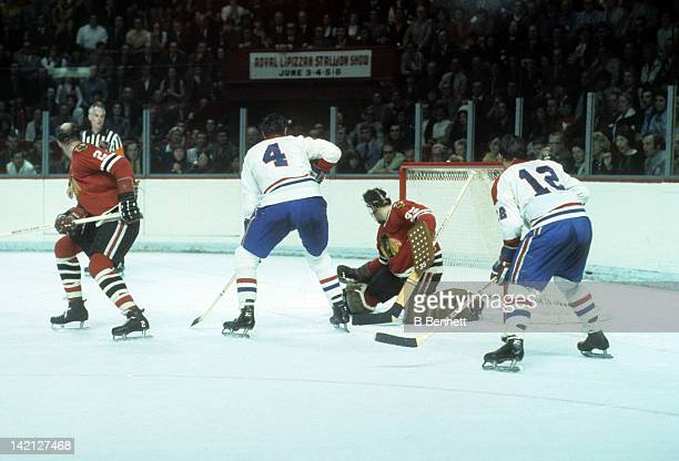 Jean Beliveau and Yvan Cournoyer of the Montreal Canadiens look to score as goalie Tony Esposito and Bill White of the Chicago Blackhawks look to...