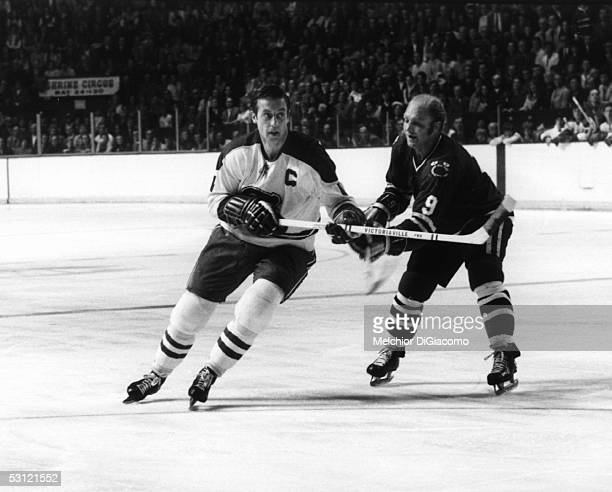 Jean Beliveau of the Montreal Canadiens battles with Bobby Hull of the Chicago Blackhawks at the Montreal Forum circa 1971 in Montreal, Quebec,...