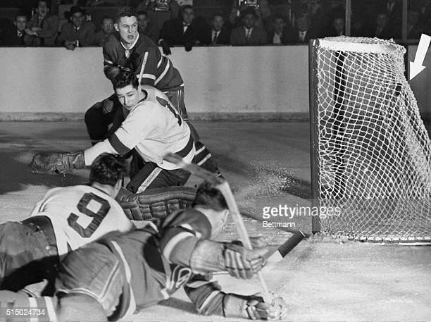 Jean Beliveau of the Montreal Canadiens blasts one past Detroit goalie Glenn Hall in second period of night game which saw the Habs take the Stanley...