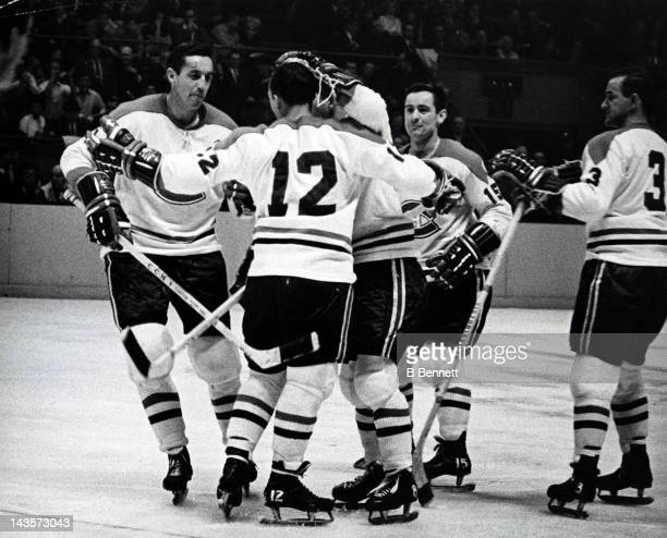 Jean Beliveau of the Montreal Canadiens celebrates with Yvan Cournoyer Dick Duff Bobby Rousseau and JC Tremblay during the game against the New York...