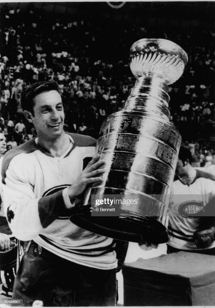 Jean Beliveau #4 of the Montreal Canadiens holds up the Stanley Cup Trophy after defeating the St. Louis Blues in Game 4 of the 1969 Stanley Cup Finals on May 4, 1969 at the St. Louis Arena in St. Louis, Missouri.