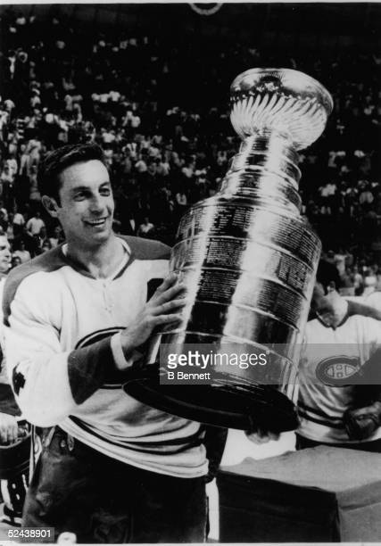 Jean Beliveau of the Montreal Canadiens holds up the Stanley Cup Trophy after defeating the St Louis Blues in Game 4 of the 1969 Stanley Cup Finals...