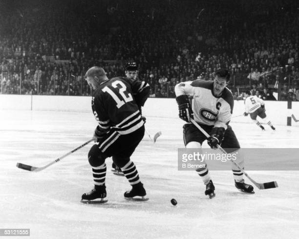 Jean Beliveau of the Montreal Canadiens looks to control the puck as Pat Stapleton of the Chicago Blackhawks over skates it during Game 3 of the 1968...