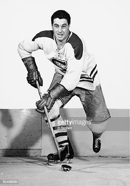 Jean Beliveau of the Montreal Canadiens poses for an action portrait circa 1950's