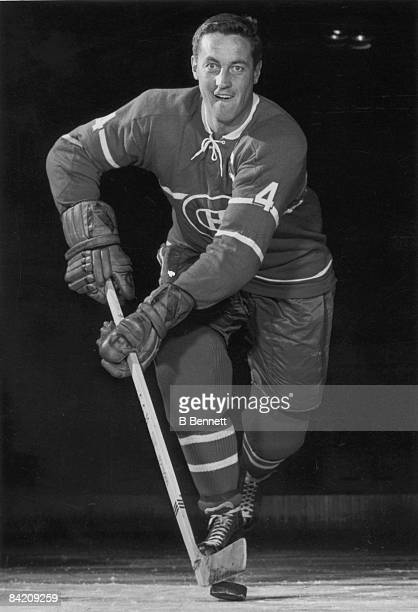 Jean Beliveau of the Montreal Canadiens poses for an action portrait circa 1965 at the Montreal Forum in Montreal Quebec Canada
