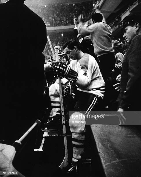 Jean Beliveau of the Montreal Canadiens sits on the bench during an NHL game against the New York Rangers on October 24 1965 at the Madison Square...