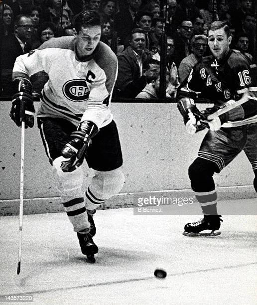 Jean Beliveau of the Montreal Canadiens skates with the puck as Rod Seiling of the New York Rangers defends on October 24 1965 at the Madison Square...