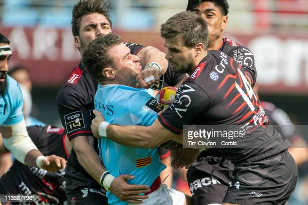 March 3: Jean Bernard Pujol of Perpignan takes a hit while tackled by Facundo Isa of Toulon, Malakai Fonokalafi Fekitoa of Toulon and Hugo Bonneval...