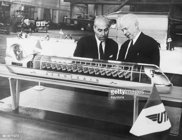 Jean Bertin inventor of the French Aérotrain and Aérotrain President Léon Kaplan present the final model of the train to the press at Le Bourget...