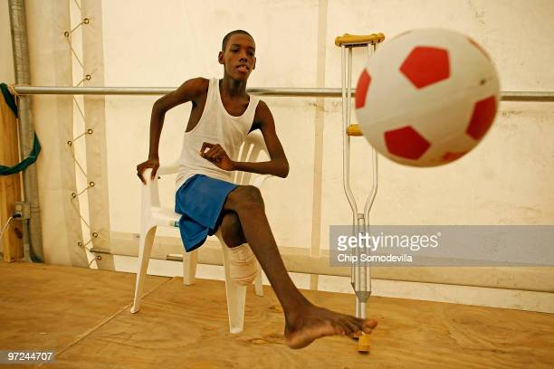 Jean Bertrand kicks a soccer ball during a physical therapy session with Handicap International on the grounds of the new Doctors Without Borders...
