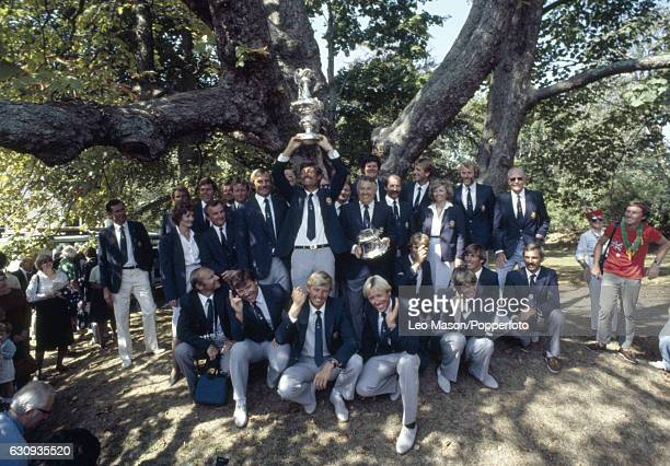 Jean Bertrand skipper of Australia II is holding the trophy alongside Alan Bond as the Australian team celebrate their victory over the USA in the...