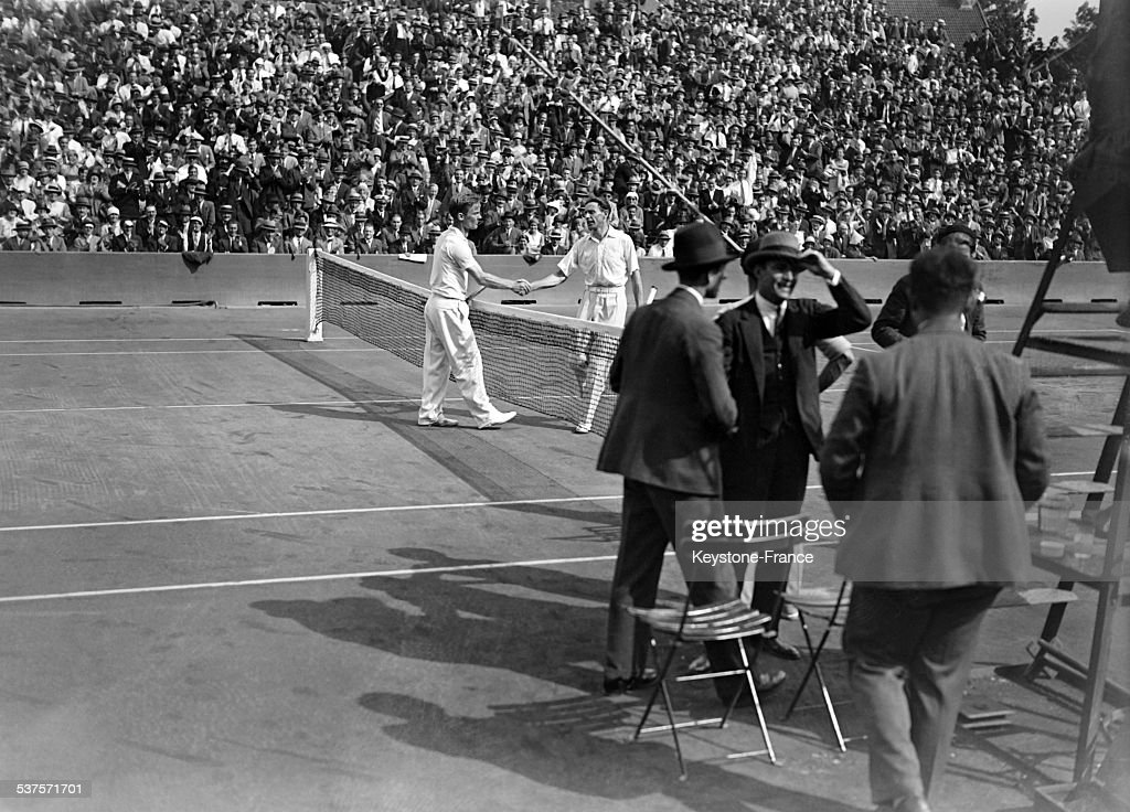 Jean Borotra and George Lott shaking hands before the Davis Cup final at Roland Garros stadium in July 1929 in Paris, France.
