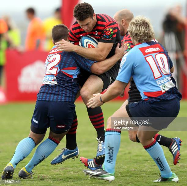 Jean Botha of College Rovers with a tackle on Duncan Taylor of Saracens during an Exhibition match between College Rovers and Saracens at John Smit...