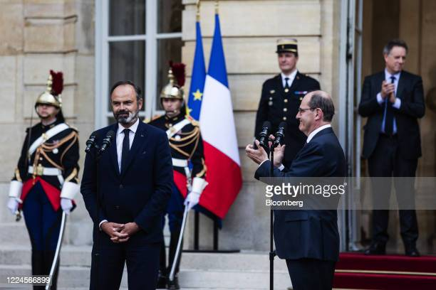 Jean Castex Frances new prime minister right applauds beside Edouard Philippe France's former prime minister during a handover ceremony at the Hotel...