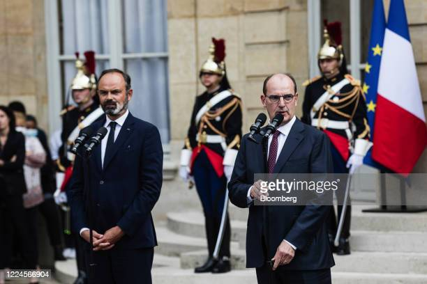 Jean Castex Frances new prime minister right delivers a speech beside Edouard Philippe France's former prime minister during a handover ceremony at...